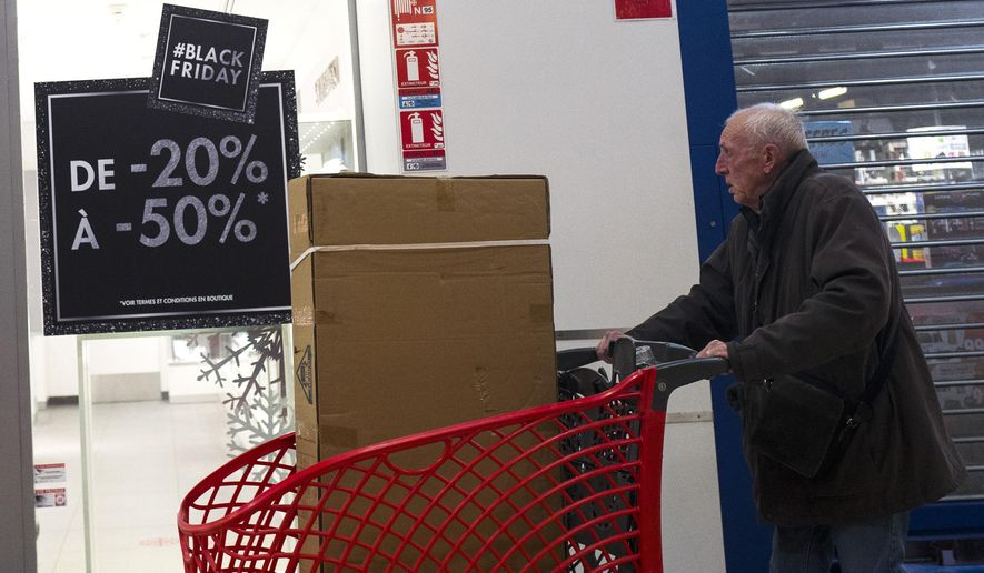 A shopper is seen during the opening of an Auchan general store, on Black Friday, Nov 29, 2019, in Englos, northern France.  Some French lawmakers want to ban Black Friday, the post-Thanksgiving sales event that has morphed into a global phenomenon.  (AP Photo/Michel Spingler)