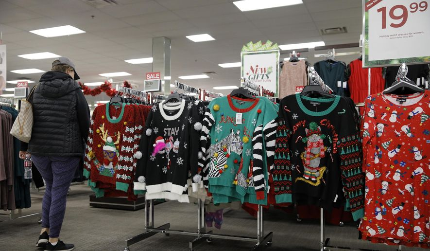 Holiday sweaters are displayed at a Kohl's ahead of Black Friday, Wednesday, Nov. 27, 2019, in Las Vegas. Black Friday once again kicks off the start of the holiday shopping season. But it will be the shortest season since 2013 because of Thanksgiving falling on the fourth Thursday in November, the latest possible date it can be. (AP Photo/John Locher)