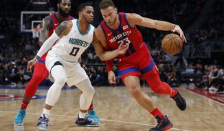 Detroit Pistons forward Blake Griffin (23) drives as Charlotte Hornets forward Miles Bridges (0) defends during the first half of an NBA basketball game, Friday, Nov. 29, 2019, in Detroit. (AP Photo/Carlos Osorio)