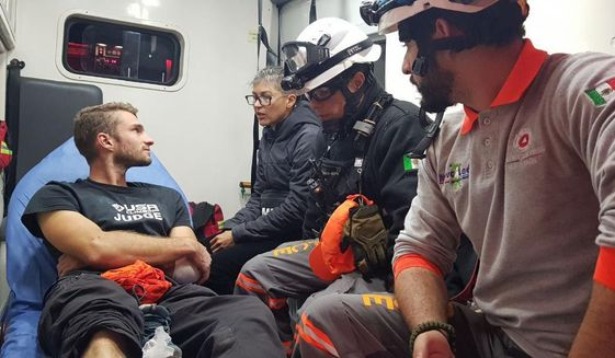In this Wednesday, Nov. 27, 2019, handout photo released by Nuevo Leon State Civil Defense Agency, survivor Aidan Jacobson sits inside an ambulance after he was rescued after falling from the El Potrero Chico peak in Hidalgo, Mexico. Jacobson was climbing with California free solo climber Brad Gobright who died in the fall, civil defense officials in northern Mexico reported Thursday. (Nuevo Leon State Civil Defense Agency via AP)