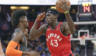 Toronto Raptors' Pascal Siakam (43) looks to pass the ball as he tries to get around Orlando Magic's Jonathan Isaac, left, during the first half of an NBA basketball game, Friday, Nov. 29, 2019, in Orlando, Fla. (AP Photo/John Raoux)
