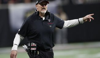Atlanta Falcons head coach Dan Quinn speaks to an official during the first half of an NFL football game against the New Orleans Saints, Thursday, Nov. 28, 2019, in Atlanta. (AP Photo/John Bazemore)