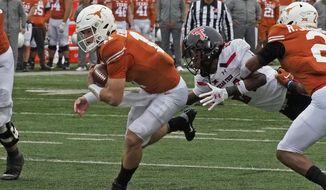 Texas quarterback Sam Ehlinger (11) runs for a touchdown during the first half of an NCAA college football game against Texas Tech, Friday, Nov. 29, 2019, in Austin, Texas. (AP Photo/Michael Thomas)
