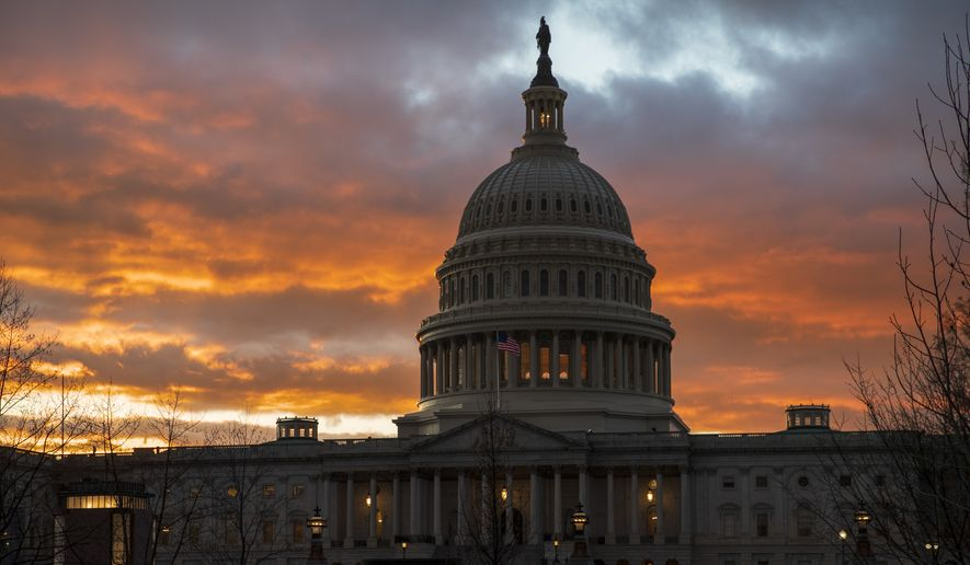 FILE- In this Jan. 24, 2019, file photo, the U.S. Capitol at sunset in Washington. Republicans have high hopes of using the House drive toward impeaching President Donald Trump to defeat Democrats from swing districts loaded with moderate voters. (AP Photo/J. Scott Applewhite, File)
