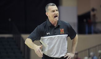 Maryland head coach Mark Turgeon reacts in front of the bench during the first half of an NCAA college basketball game against Harvard Friday, Nov. 29, 2019, in Lake Buena Vista, Fla. (AP Photo/Phelan M. Ebenhack) ** FILE **