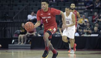 Maryland guard Anthony Cowan Jr. (1) pushes the ball up the court in front of Harvard guard Justin Bassey (20) during the second half of an NCAA college basketball game Friday, Nov. 29, 2019, in Lake Buena Vista, Fla. (AP Photo/Phelan M. Ebenhack) ** FILE **