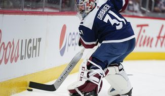 Colorado Avalanche goaltender Philipp Grubauer clears the puck during the second period of an NHL hockey game against the Chicago Blackhawks Saturday, Nov. 30, 2019, in Denver. (AP Photo/Jack Dempsey)