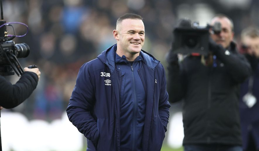 Derby County assistant coach Wayne Rooney looks on during the English Championship soccer match between Derby County and Queen's Park Rangers at Pride Park, Derby, England, Saturday, Dec. 30, 2019. (Tim Goode/PA via AP)