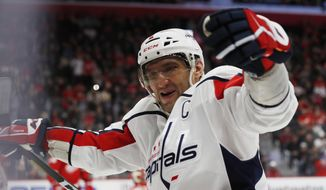 Washington Capitals left wing Alex Ovechkin celebrates the goal of right wing Tom Wilson during the third period of the team's NHL hockey game against the Detroit Red Wings, Saturday, Nov. 30, 2019, in Detroit. (AP Photo/Carlos Osorio) ** FILE **