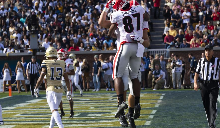 Georgia wide receiver Tyler Simmons (87) celebrates a touchdown with tight end Charlie Woerner during the first half of an NCAA college football game against Georgia Tech, Saturday, Nov. 30, 2019 in Atlanta. Woerner scored on the play. (AP Photo/John Amis)