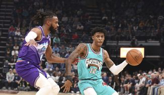 Memphis Grizzlies guard Ja Morant looks to pass as Utah Jazz guard Mike Conley (10) defends in the first half of an NBA basketball game Friday, Nov. 29, 2019, in Memphis, Tenn. (AP Photo/Karen Pulfer Focht)