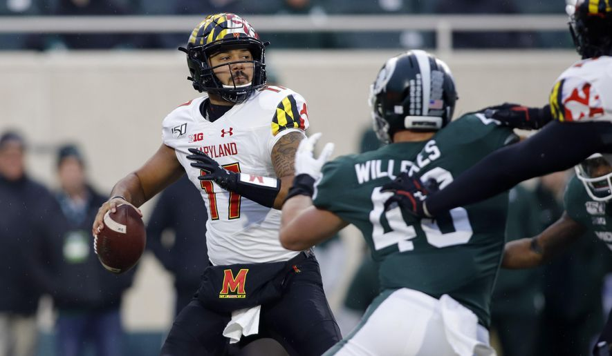 Maryland quarterback Josh Jackson, left, looks to throw against Michigan State's Kenny Willekes during the first half of an NCAA college football game, Saturday, Nov. 30, 2019, in East Lansing, Mich. (AP Photo/Al Goldis) ** FILE **