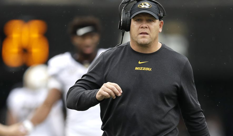 FILE - In this Oct. 19, 2019 file photo, Missouri head coach Barry Odom watches from the sideline in the first half of an NCAA college football game against Vanderbilt in Nashville, Tenn.   A person with direct knowledge of the decision says Missouri has fired Odom. The person spoke to The Associated Press on condition of anonymity Saturday, Nov. 30,  because no announcement has been made.  (AP Photo/Mark Humphrey, File)
