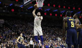 Philadelphia 76ers' Ben Simmons dunks during the second half of the team's NBA basketball game against the Indiana Pacers, Saturday, Nov. 30, 2019, in Philadelphia. (AP Photo/Matt Slocum)