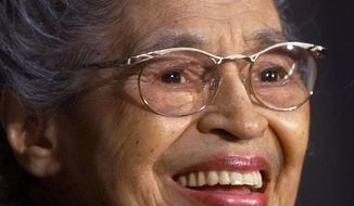 In a June 15, 1999 file photo Rosa Parks smiles during a Capitol Hill ceremony where Parks was honored with the Congressional Gold Medal in Washington. A new statue of civil rights pioneer Rosa Parks will be unveiled in downtown Montgomery, Ala., on Sunday, Dec. 1, 2019.  (AP Photo/Khue Bui, File)
