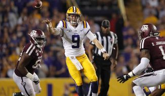 LSU quarterback Joe Burrow (9) throw a pass during the first half of the team's NCAA college football game against Texas A&M in Baton Rouge, La., Saturday, Nov. 30, 2019. (AP Photo/Gerald Herbert)