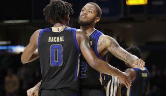 Tulsa's Brandon Rachal (0) and Reggie Jones celebrate the team's 67-58 win over Vanderbilt in an NCAA college basketball game Saturday, Nov. 30, 2019, in Nashville, Tenn. (AP Photo/Mark Humphrey)