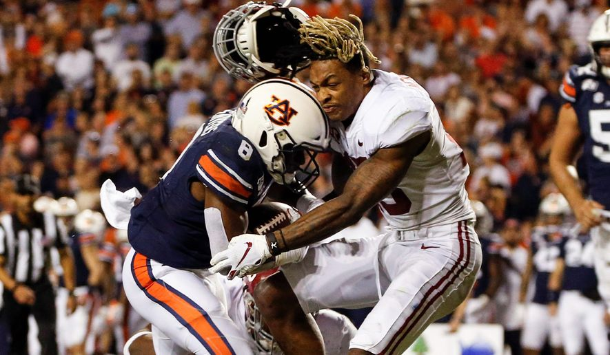 Defensive back Xavier McKinney (right) and his Alabama teammates dropped to No. 9 in the Top 25 poll, breaking a string of top-five appearances for the Crimson Tide that began in 2015. Alabama lost on Saturday to Auburn in the Iron Bowl. (Associated Press)