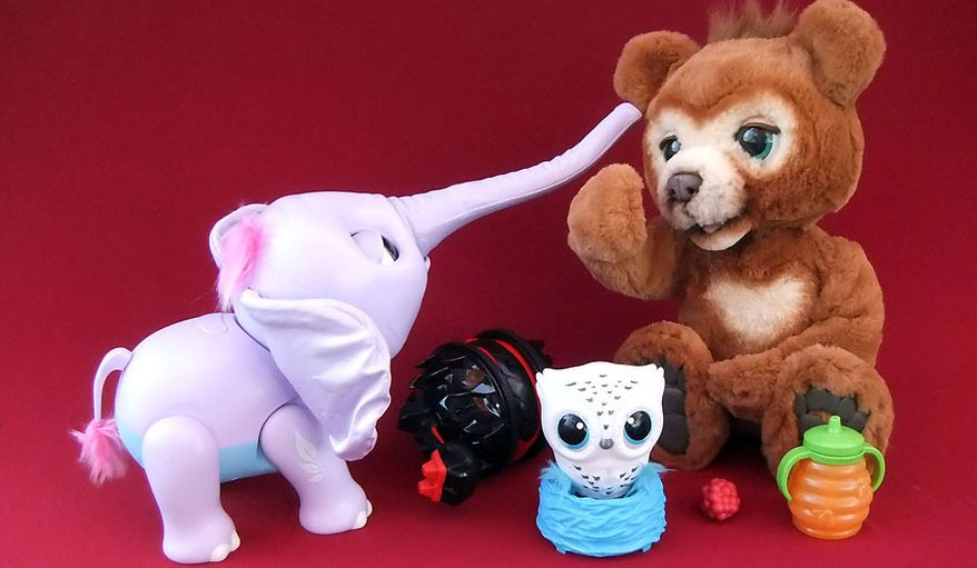 Coolest interactive creatures for gifting include The Alpha Group's Grrrumball, Spin Master's Owleez and Juno and Hasbro's Cubby (Photograph by Joseph Szadkowski / The Washington Times)