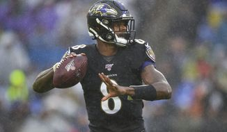Baltimore Ravens quarterback Lamar Jackson (8) looks downfield to pass the ball against San Francisco 49ers in the first half of an NFL football game, Sunday, Dec. 1, 2019, in Baltimore, Md. (AP Photo/Gail Burton)