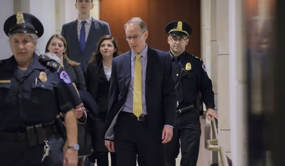 Mark Sandy, a career employee in the White House Office of Management and Budget, arrives at the Capitol to testify in the House Democrats' impeachment inquiry about President Donald Trump's effort to tie military aid for Ukraine to investigations of his political opponents, in Washington, Saturday, Nov. 16, 2019. (AP Photo/J. Scott Applewhite)
