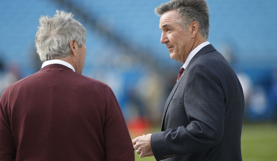 Washington Redskins general manager Bruce Allen, right, is seen prior to an NFL football game between the Carolina Panthers and the Washington Redskins in Charlotte, N.C., Sunday, Dec. 1, 2019. (AP Photo/Brian Blanco)