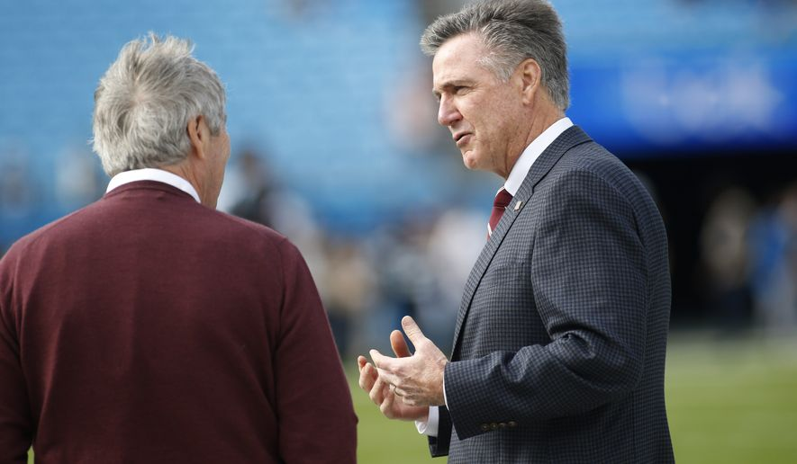 Washington Redskins general manager Bruce Allen, right, is seen prior to an NFL football game between the Carolina Panthers and the Washington Redskins in Charlotte, N.C., Sunday, Dec. 1, 2019. (AP Photo/Brian Blanco) ** FILE **