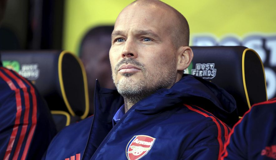 Arsenal's interim head coach Freddie Ljungberg looks out during the match against Norwich City, during their English Premier League soccer match at Carrow Road in Norwich, England, Sunday Dec. 1, 2019. (Adam Davy/PA via AP)