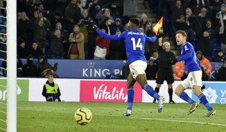 Leicester's Kelechi Iheanacho, center, celebrates after scoring his side's second goal during the English Premier League soccer match between Leicester City and Everton at the King Power Stadium in Leicester, England, Sunday, Dec. 1, 2019. (AP Photo/Rui Vieira)