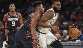 Boston Celtics guard Jaylen Brown (7) dribbles as New York Knicks guard Dennis Smith Jr. (5) defends during the second half of an NBA basketball game, Sunday, Dec. 1, 2019, in New York. (AP Photo/Sarah Stier)