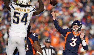 Denver Broncos quarterback Drew Lock passes under pressure form Los Angeles Chargers defensive end Melvin Ingram during the first half of an NFL football game Sunday, Dec. 1, 2019, in Denver. (AP Photo/Jack Dempsey)