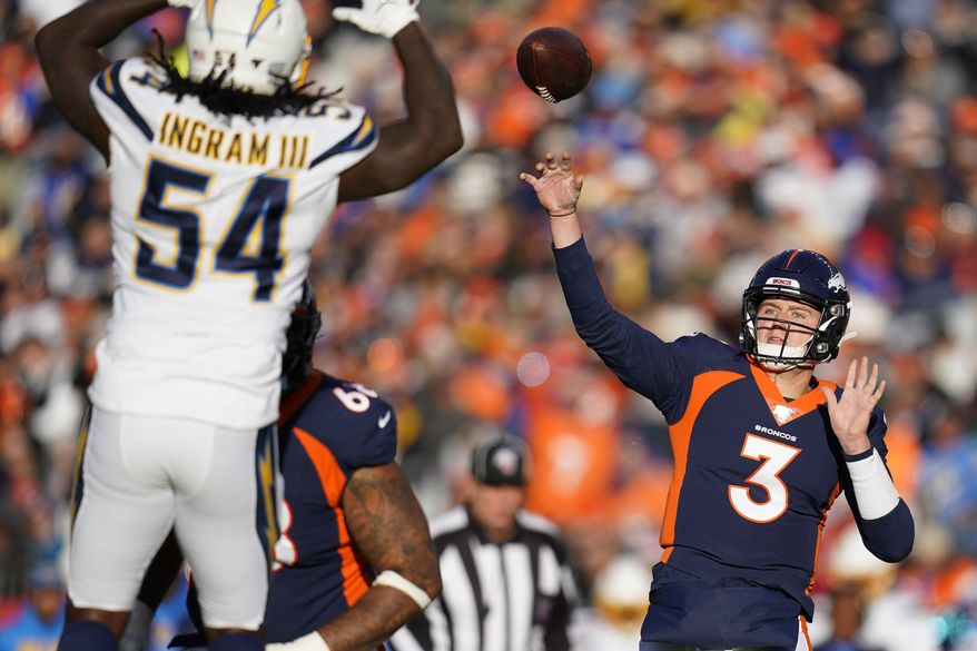 Denver Broncos quarterback Drew Lock passes under pressure form Los Angeles Chargers defensive end Melvin Ingram during the first half of an NFL football game Sunday, Dec. 1, 2019, in Denver. (AP Photo/Jack Dempsey)