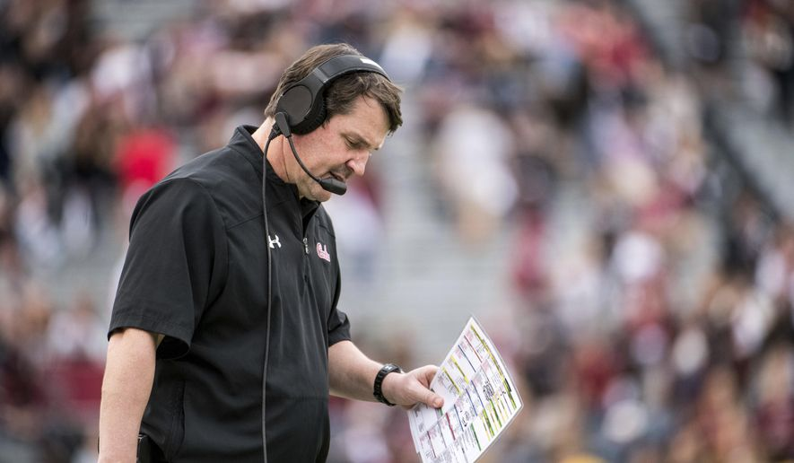 South Carolina head coach Will Muschamp walks on the sideline during the second half of an NCAA college football game against Clemson, Saturday, Nov. 30, 2019, in Columbia, S.C. Clemson defeated South Carolina 38-3. (AP Photo/Sean Rayford)