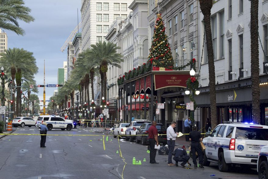 New Orleans police investigate the scene of a shooting Sunday, Dec. 1, 2019, on the edge of the city's famed French Quarter in New Orleans.  (Max Becherer/The Advocate via AP)