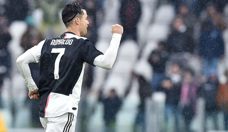 Juventus' Cristiano Ronaldo reacts after scoring the final equalizer during the Italian Serie A soccer match between Juventus and Sassuolo at the Allianz Stadium in Turin, Italy, Sunday, Dec. 1, 2019. (Alessandro Di Marco/ANSA via AP)