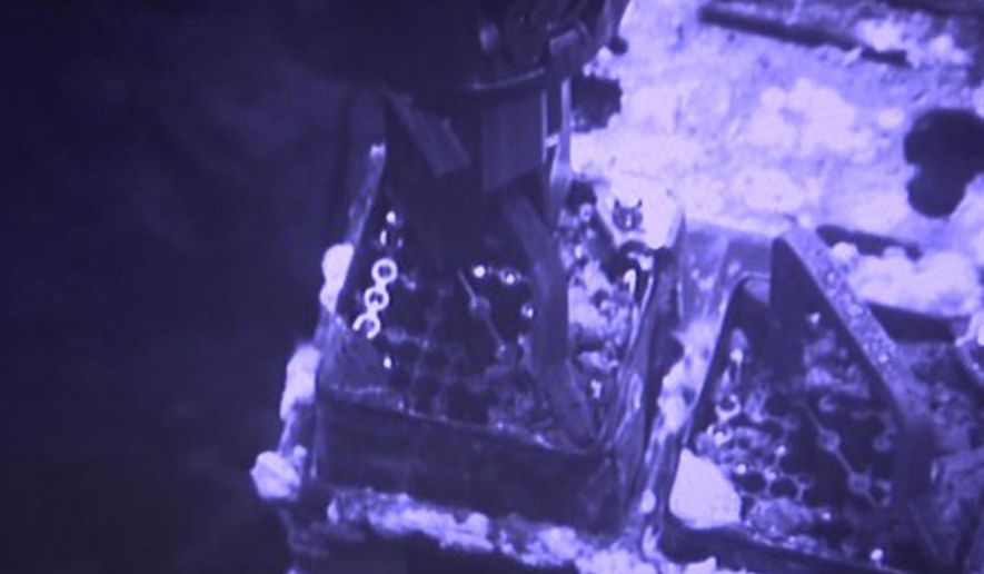 FILE - This April 15, 2019, file image released by Tokyo Electric Power Co. (TEPCO) shows an operation to remove fuel from a cooling pool at Unit 3 of the Fukushima nuclear plant in Okuma town, Fukushima prefecture, northeastern Japan. Japan's economy and industry ministry unveiled a draft revision Monday, Dec. 2, 2019, to its decades-long roadmap to clean up the radioactive mess at the Fukushima nuclear power plant, which was wrecked by a massive earthquake and tsunami in 2011. (Tokyo Electric Power Co. via AP, File)