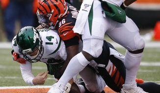 New York Jets quarterback Sam Darnold (14) is sacked by Cincinnati Bengals defensive end Carlos Dunlap (96) during the second half of an NFL football game, Sunday, Dec. 1, 2019, in Cincinnati. (AP Photo/Gary Landers)