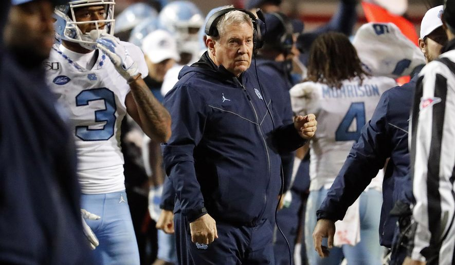 North Carolina head coach Mack Brown watches from the sideline during the second half of an NCAA college football game against North Carolina State in Raleigh, N.C., Saturday, Nov. 30, 2019. (AP Photo/Karl B DeBlaker)