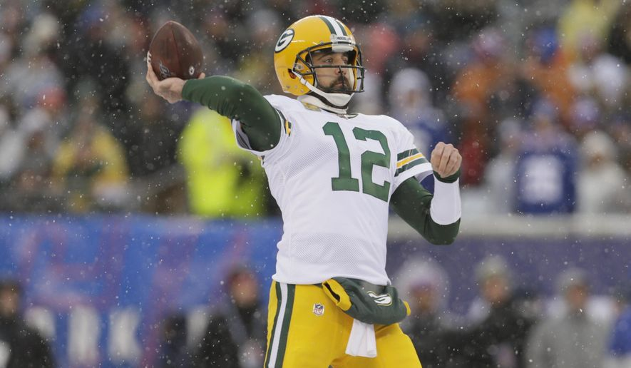 Green Bay Packers quarterback Aaron Rodgers passes during the first half of an NFL football game against the New York Giants, Sunday, Dec. 1, 2019, in East Rutherford, N.J. (AP Photo/Adam Hunger)