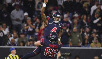 Houston Texans quarterback Deshaun Watson (4) is lifted by center Nick Martin (66) as they celebrate a touchdown against the New England Patriots during the first half of an NFL football game Sunday, Dec. 1, 2019, in Houston. (AP Photo/Eric Christian Smith)