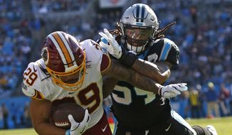 Carolina Panthers outside linebacker Shaq Thompson tackles Washington Redskins running back Derrius Guice (29) during the first half of an NFL football game in Charlotte, N.C., Sunday, Dec. 1, 2019. (AP Photo/Brian Blanco) ** FILE **