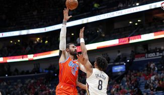 Oklahoma City Thunder center Steven Adams (12) shoots over New Orleans Pelicans center Jahlil Okafor (8) in the first half of an NBA basketball game in New Orleans, Sunday, Dec. 1, 2019. (AP Photo/Gerald Herbert)