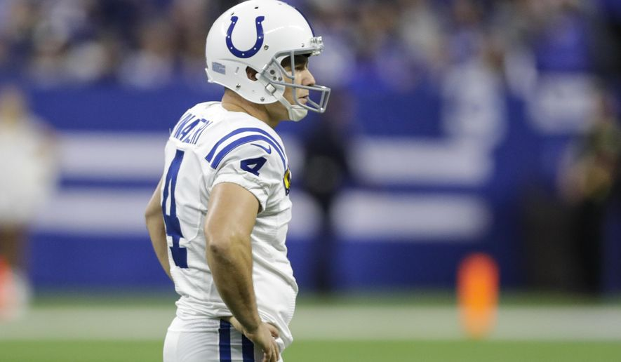 Indianapolis Colts kicker Adam Vinatieri (4) watches after his field goal attempt was blocked and returned for a touchdown by the Tennessee Titans during the second half of an NFL football game in Indianapolis, Sunday, Dec. 1, 2019. (AP Photo/Darron Cummings)