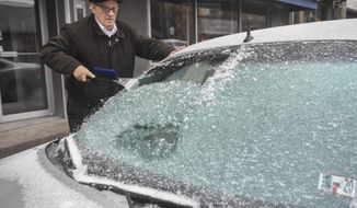 Paul Ciotti, of Minersville, Pa., scrapes ice off of his car windshield parked along Sunbury Street in Minersville, Pa., on Sunday, Dec. 1, 2019. (Jacqueline Dormer/Republican-Herald via AP)