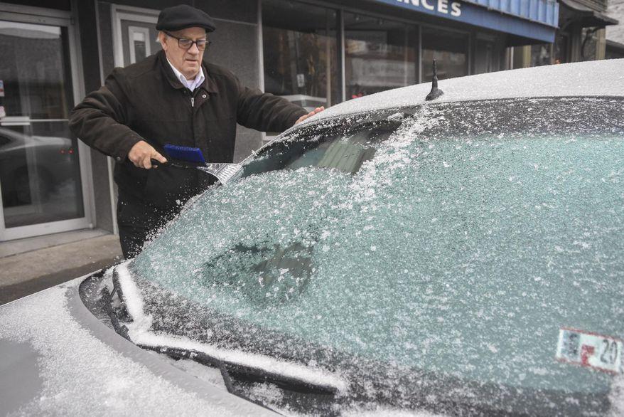 Paul Ciotti, of Minersville, Pa., scrapes ice off of his car windshield parked along Sunbury Street in Minersville, Pa., on Sunday, Dec. 1, 2019. (Jacqueline Dormer/Republican-Herald via AP)
