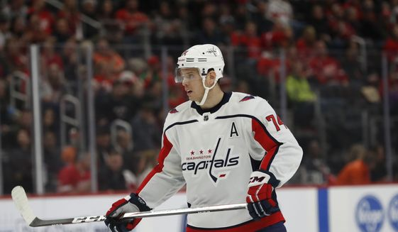 Washington Capitals defenseman John Carlson is seen during the first period of an NHL hockey game, Saturday, Nov. 30, 2019, in Detroit. (AP Photo/Carlos Osorio) ** FILE **