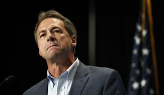 In this Sunday, June 9, 2019, file photo, Democratic presidential candidate Steve Bullock speaks during the Iowa Democratic Party's Hall of Fame Celebration, in Cedar Rapids, Iowa. Bullock announced Monday, Dec. 2, 2019, that he is ending his Democratic presidential campaign. (AP Photo/Charlie Neibergall, File)