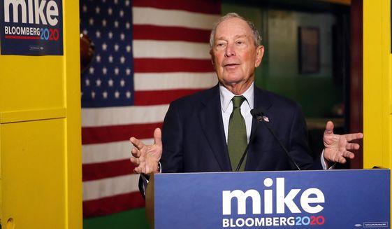 In this Nov. 26, 2019, photo, Democratic presidential candidate Michael Bloomberg speaks to the media in Phoenix. (AP Photo/Rick Scuteri) ** FILE **
