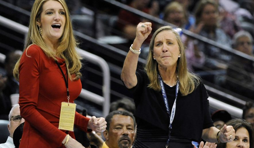 -In this Tuesday, Sept. 6, 2011 file photo, Mary Brock, right, and Kelly Loeffler cheer from their courtside seats as the Atlanta Dream basketball team plays in the second half of their WNBA basketball game, in Atlanta. Republican donor and financial services executive Loeffler tapped by Georgia governor Kemp for U.S. Senate seat as three-term Republican Sen. Johnny Isakson, who is stepping down because of health issues. (AP Photo/David Tulis, ) **FILE**
