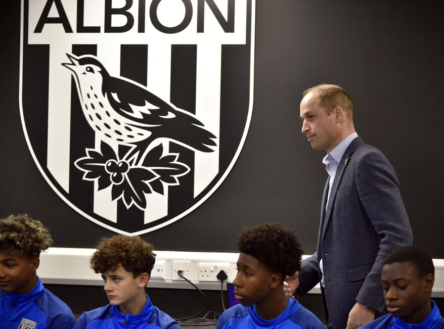 Britain's Prince William meets young players from West Brom's Academy as part of the Heads Up campaign during a visit to West Bromwich Albion Training Ground in Walsall, England, Thursday, Nov. 28, 2019. (AP Photo/Rui Vieira, Pool)
